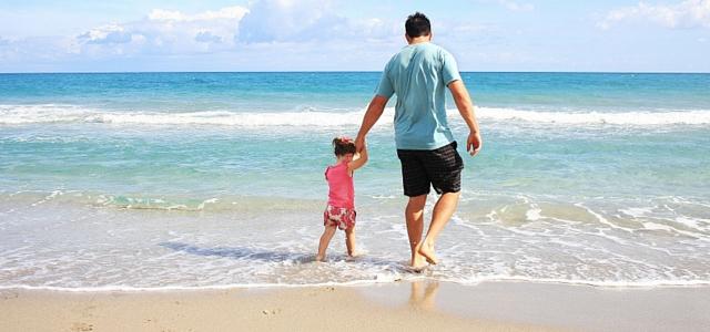 family on beach cornwall