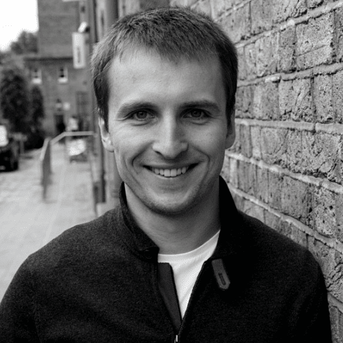 Man Smiling Against Wall
