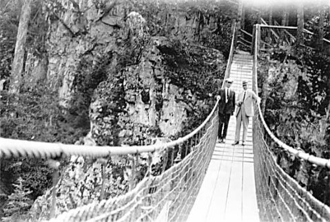 Vancouver mayor L.D. Taylor and unidentified man on the Capilano Suspension Bridge (circa 1930) Photo from the Vancouver Archives online database.
