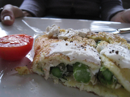 Asparagus and goat cheese omelette with extra goat cheese on top and fresh-cracked pepper