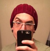 Andrew's selfie modeling the hat
