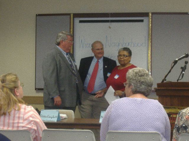 Salisbury City Councilwoman Shanie Shields (right) discusses the issues with Rick Pollitt (left) and Rocky Burnett (center).