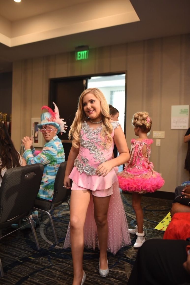 Eden arrives to judge the pageant.