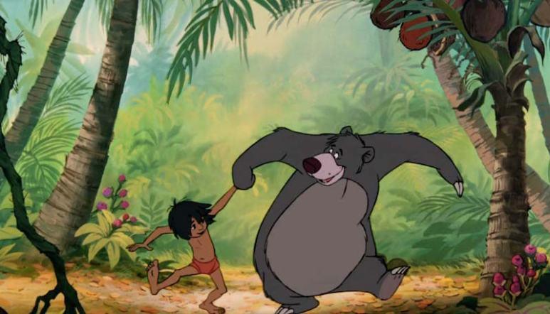 Baloo the bear and Mowgli dance in the original The Jungle Book movie
