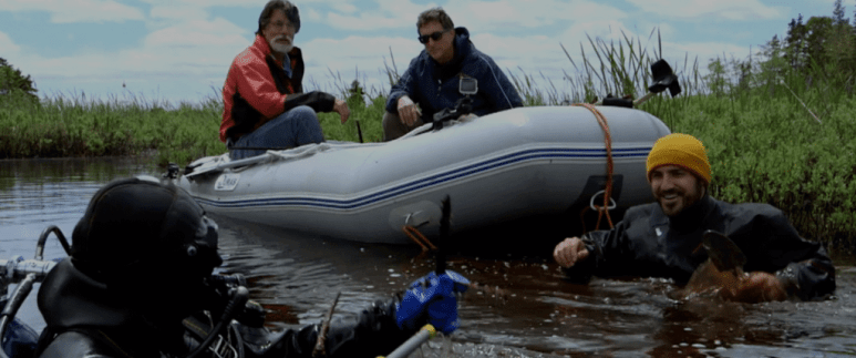 The team explore the Oak Island swamp with a diver and inflatable