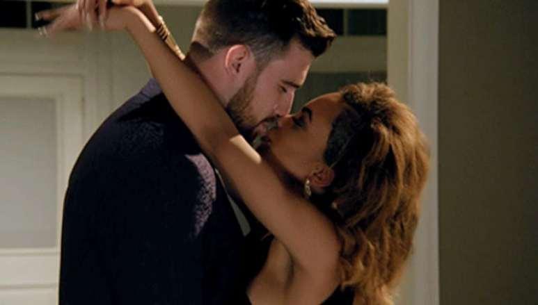 Travis kisses Maya after choosing her as the winner in the Catching Kelce season finale