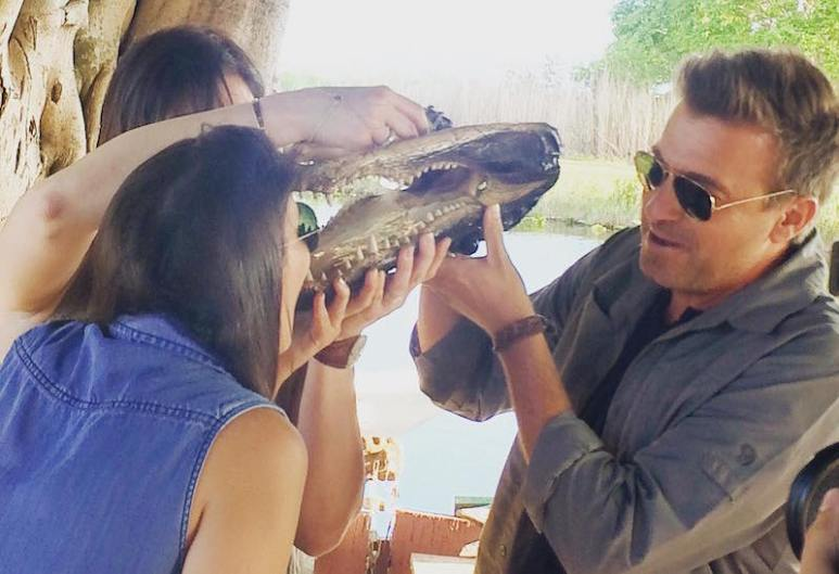 Jack holds the alligator's jaw as whiskey trickles through its teeth on Booze Traveler