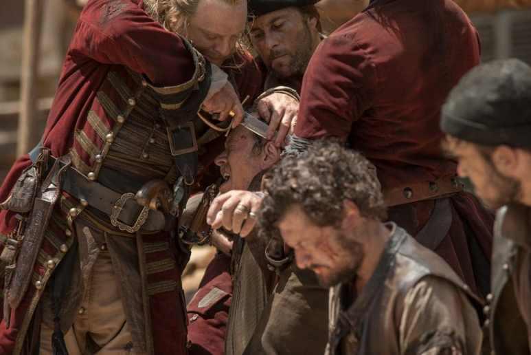 Captain Berringer cutting the ear off De Groot