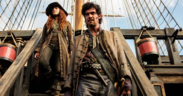 Bonny and Calico Jack Rackham walking down some stairs