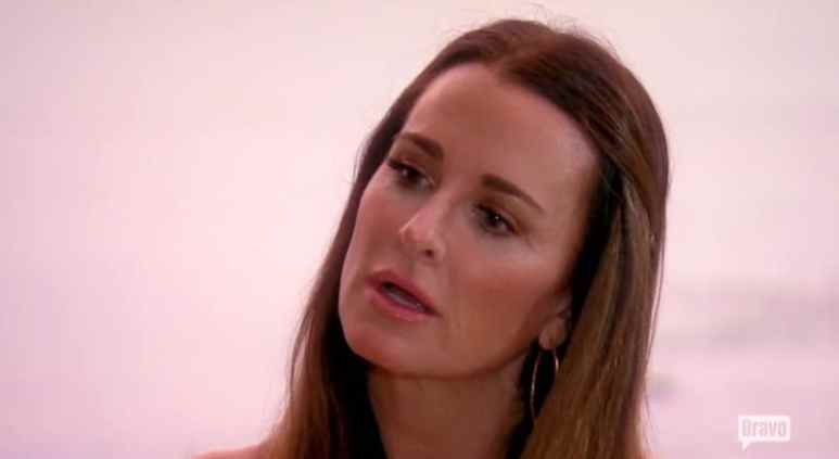 Kyle Richards reacts as Lisa Vanderpump tells her about Lisa Rinna's comments on RHOBH