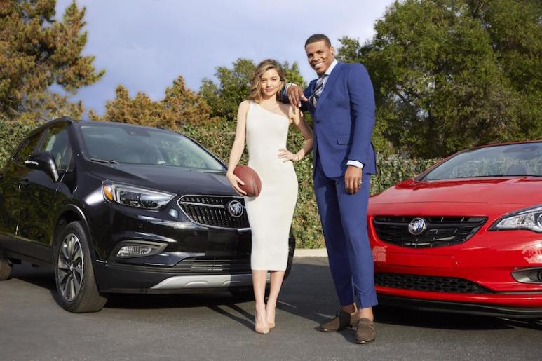 Newton and Kerr in a photoshoot for Buick as part of their Super Bowl campaign
