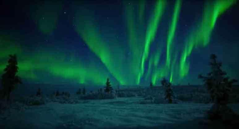 The northern lights put on an incredible display above the snowy vista of Lapland