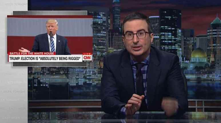 John Oliver with a picture of Donald Trump behind him