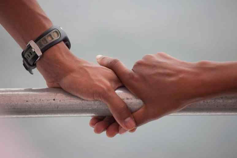 Barack Obama and Michelle Obama's hands rest on the railing in Panama City Beach, Fla., Aug. 15, 2010. Credit: Pete Souza, The White House