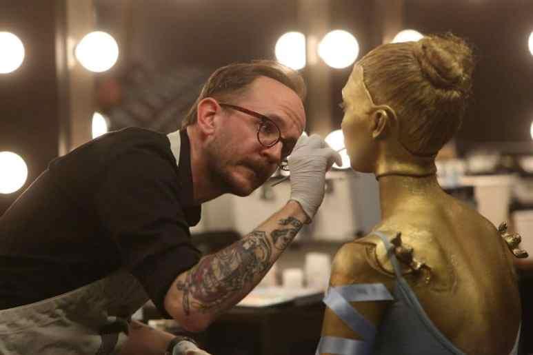 Ben Ploughman painting a model gold