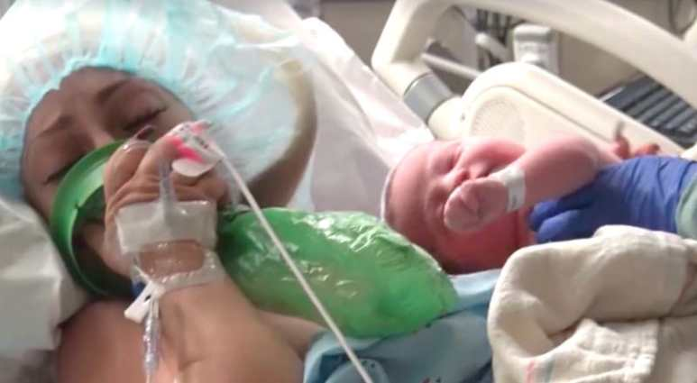Jasmine breathes gas as newborn Benjamin is taken off her by a nurse on Little Women: LA