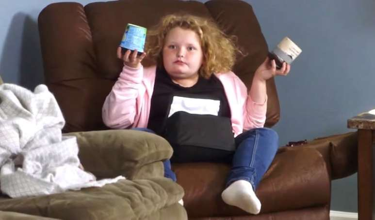 """Honey Boo Boo holds up Mama June's ice-cream stash with a look that says """"WTF?"""""""