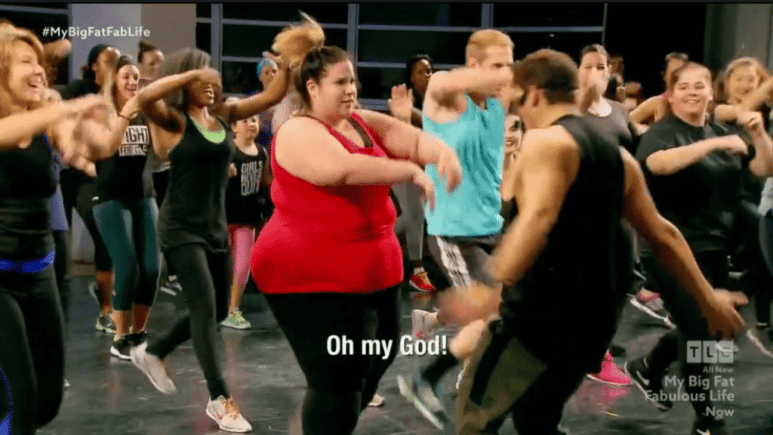 Whitney and Todd dance with the Fitness Marshall before things get out of hand