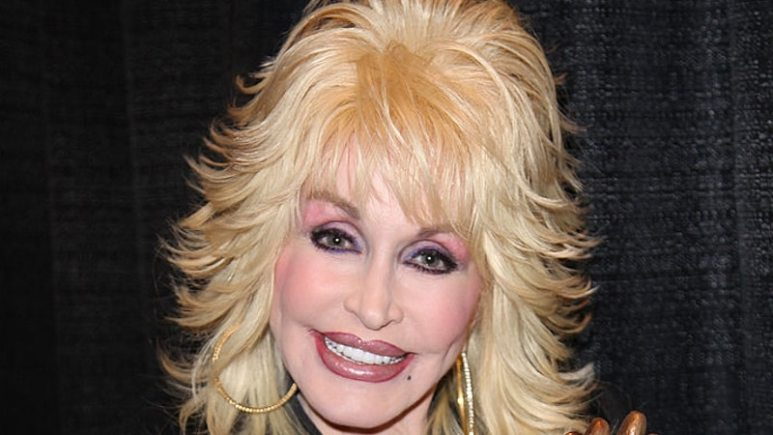 National Enquirer Investigates Dolly parton, pictured here at an award ceremony