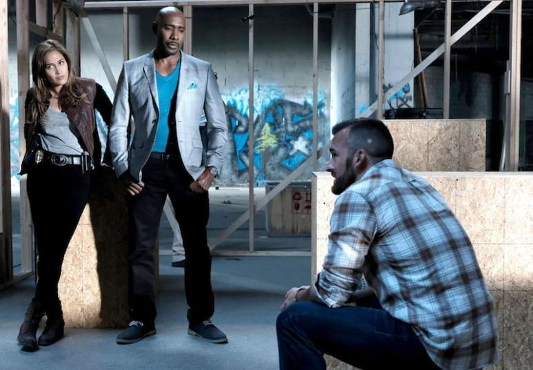 Austin filming a scene with Rosewood's Jaina Lee Ortiz and Morris Chestnut