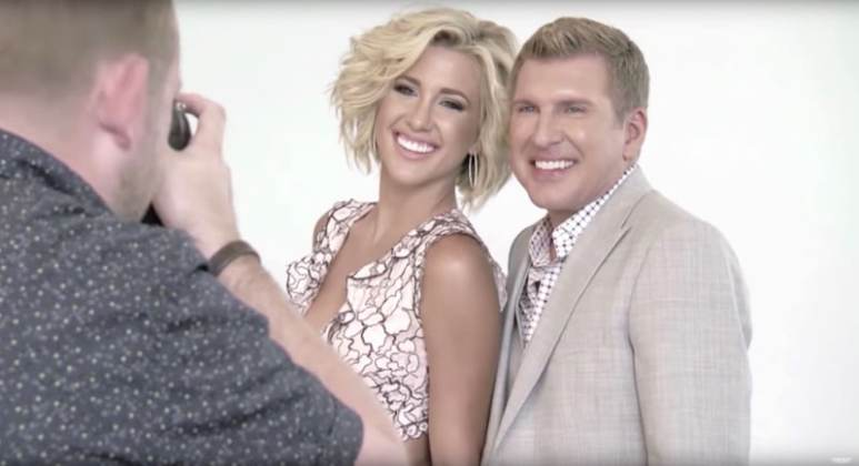 Savannah and Todd taking part in a photoshoot in a clip from Chrisley Knows Best