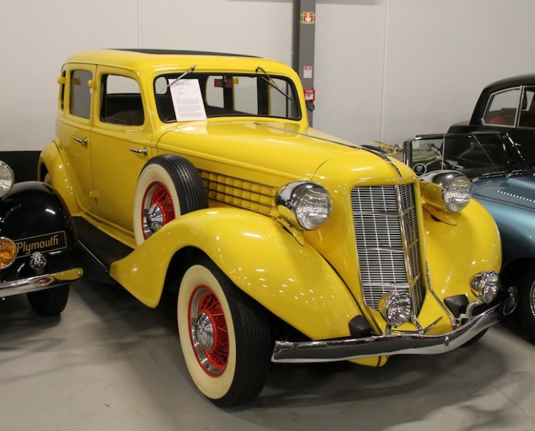 A yellow 1936 Auburn Model 653, similar to the car restored on American Pickers