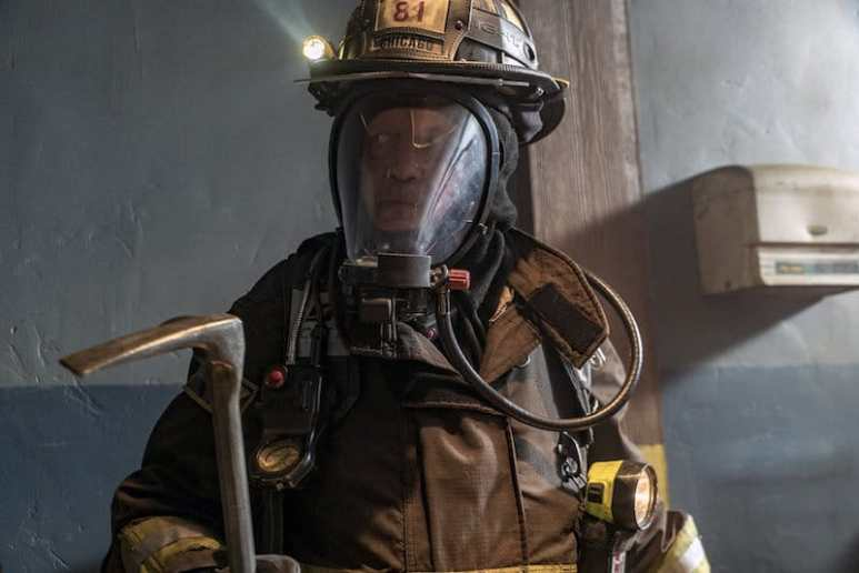 Randall McHolland in his gear with a flashlight on his helmet