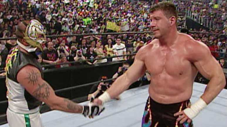 Eddie Guerrero shaking hands with Rey Mysterio in the ring