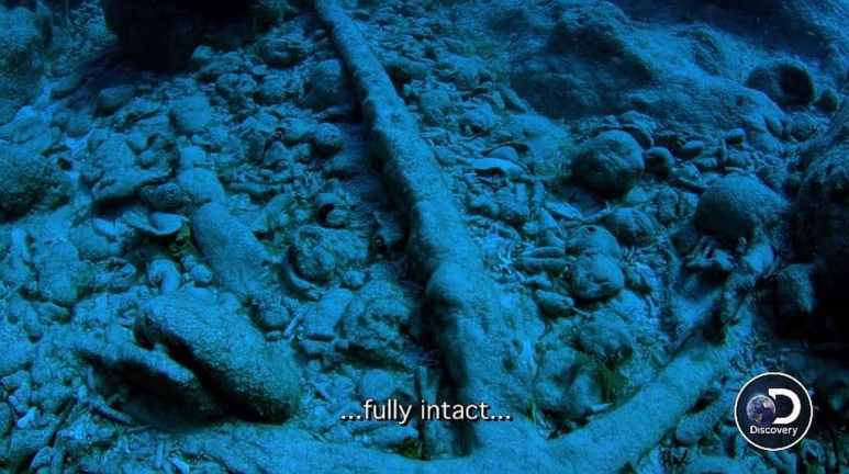 The anchor on the seabed, with a caption reading 'fully intact'