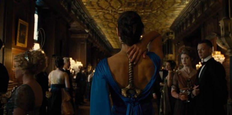 Wonder Woman (Gal Gadot) reaches for her sword.