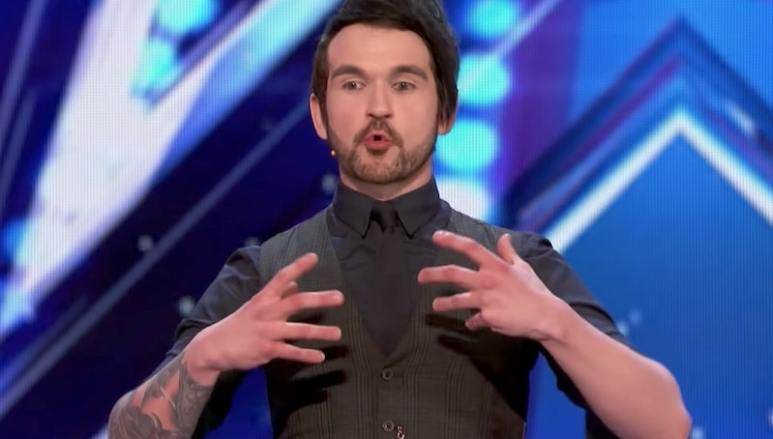 Colin Cloud talking on stage during his America's Got Talent audition
