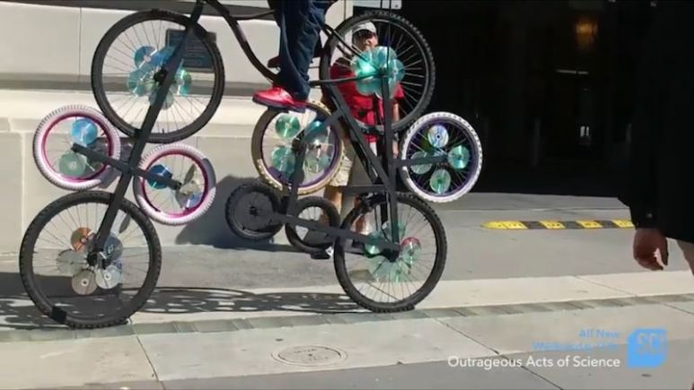 The wheels of the bike while it's being ridden