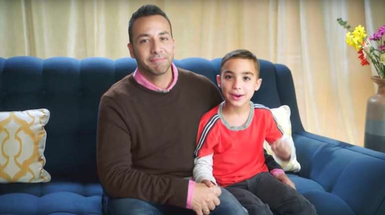 Howie D sitting next to his son James on Big Star, Little Star
