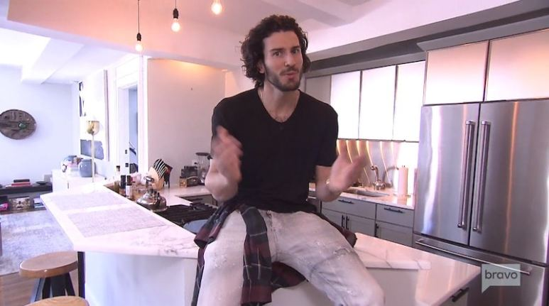 Million Dollar Listing New York's Steve Gold talking to the camera in the kitchen of his NYC apartment