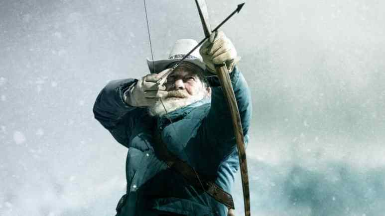 Tom Oar pulling an arrow back from a bow in a promotional Mountain Men photo