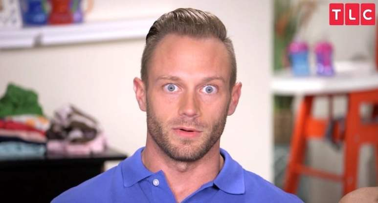 A wide-eyed Adam Busby talking to the camera on Outdaughtered
