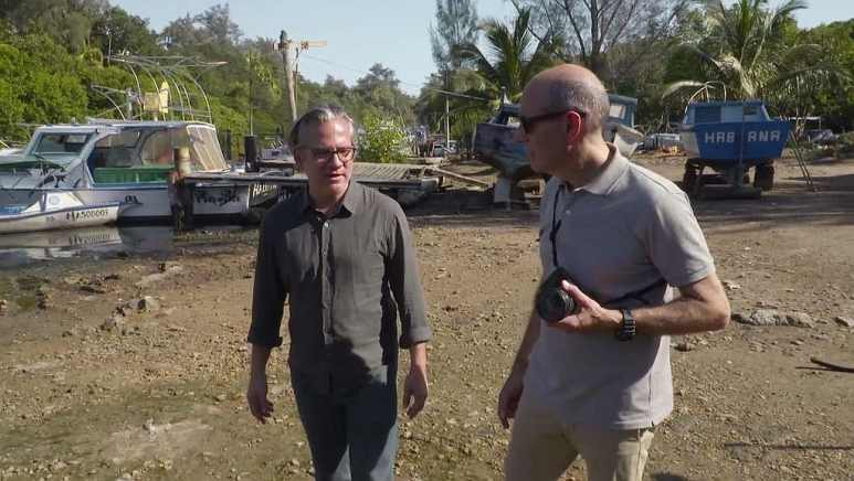 PBS host Geoffrey Baer and Hugo Perez walking together