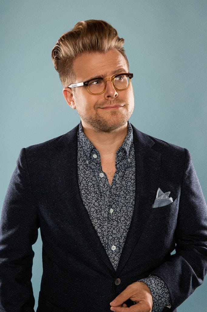 Adam Conover posing in a promotional photo