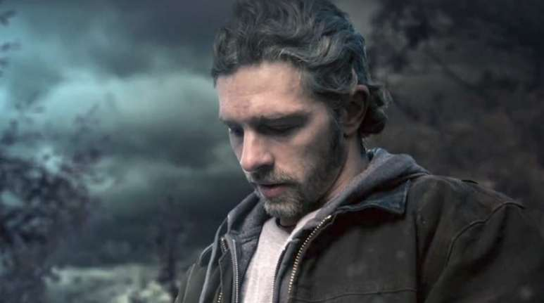 Matt looking down at the ground in a photo from Alaskan Bush People