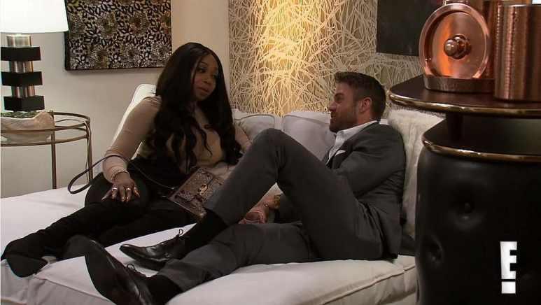 Tiffany Pollard and Chad Johnson talking on a bed