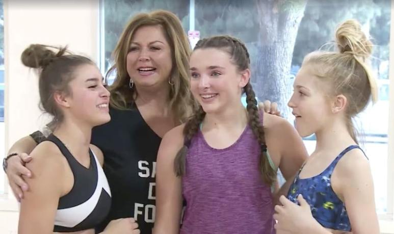 Abby Lee Miller standing with some of her dancers on Dance Moms