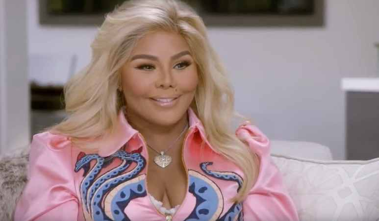 Lil' Kim smiles at reading with Tyler Henry