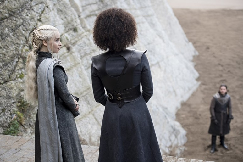 Daenerys and Missandei looking to Jon Snow.
