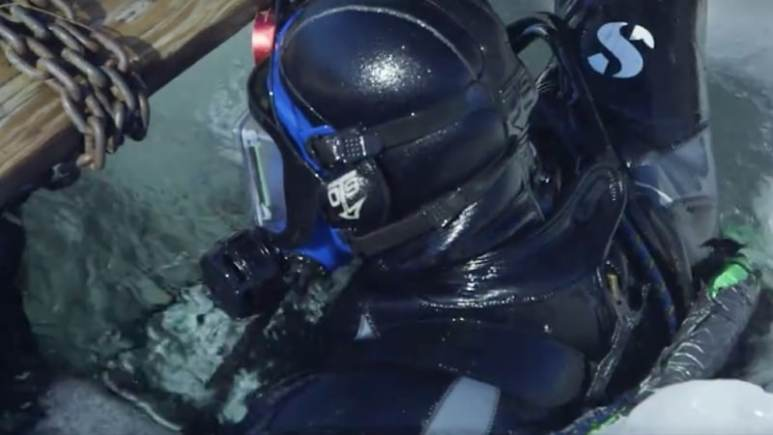 Andy on the surface with his head through the ice
