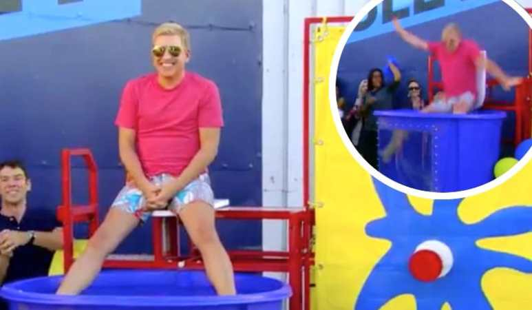 Todd Chrisley sitting above a dunk pool on According To Chrisley