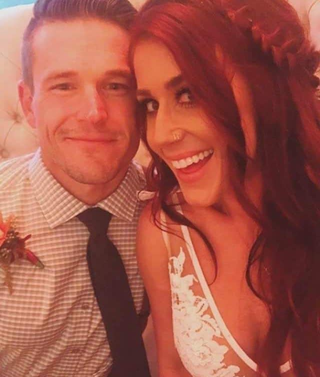 Jenelle and Cole at their wedding reception in a selfie