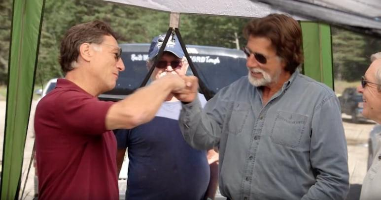 Marty and Rick Lagina fist-pumping