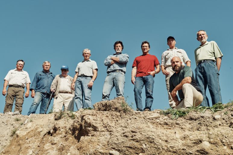 The Curse of Oak Island team above what looks like the excavated hole