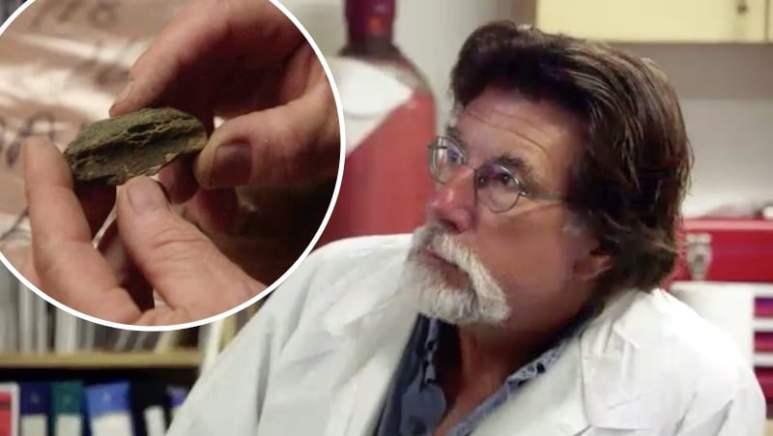 Rick Lagina and bone fragment on The Curse of Oak Island
