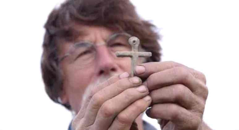 Rick Lagina and medieval cross on The Curse of Oak Island